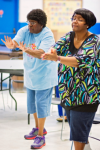 Two African American women practicing Tai Chi