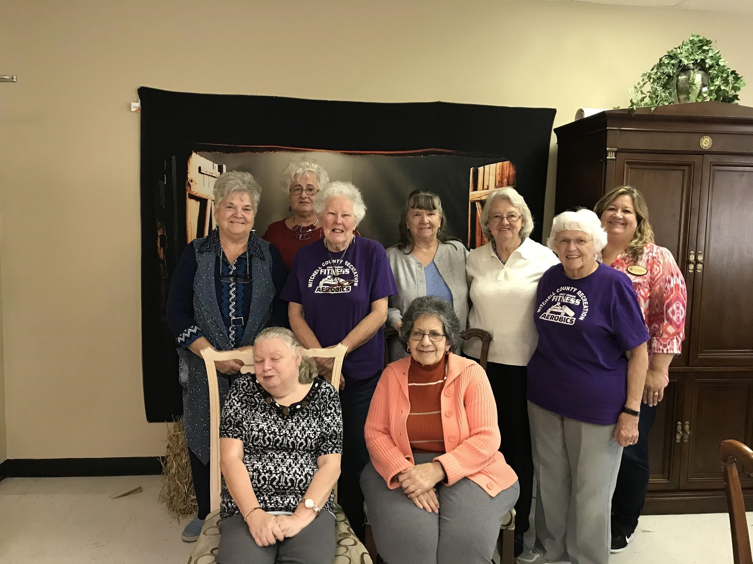group of woman at the senior center posing for picture